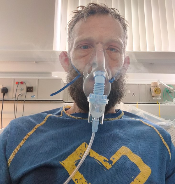 Picture of Andy wearing a nebulizer mask